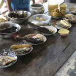 Bowls of amazon river food displayed on a wooden table.